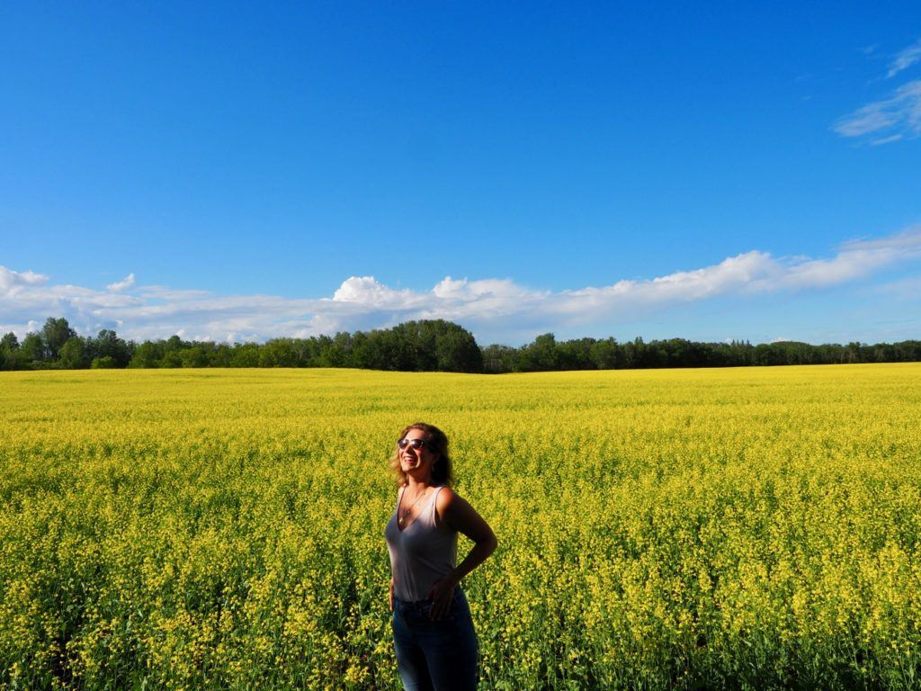 Brenna in canola fields Swan Valley Manitoba
