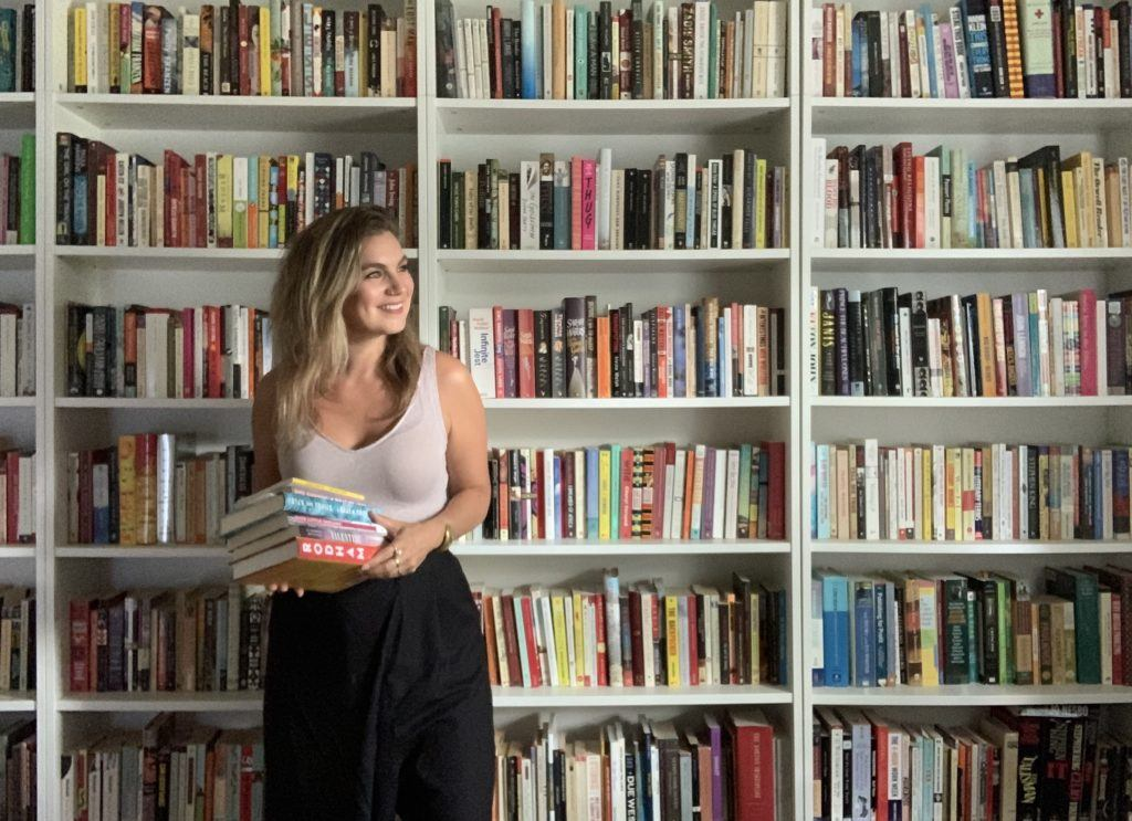 Brenna in office with books