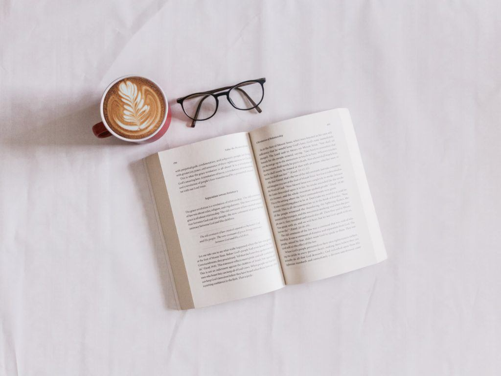 open book with glasses and coffee