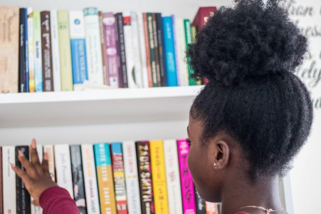 picking a book from a bookshelf